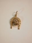 14 kt. Yellow Gold Horseshoe w/ 8 mm Equinite. Charm/Pendant